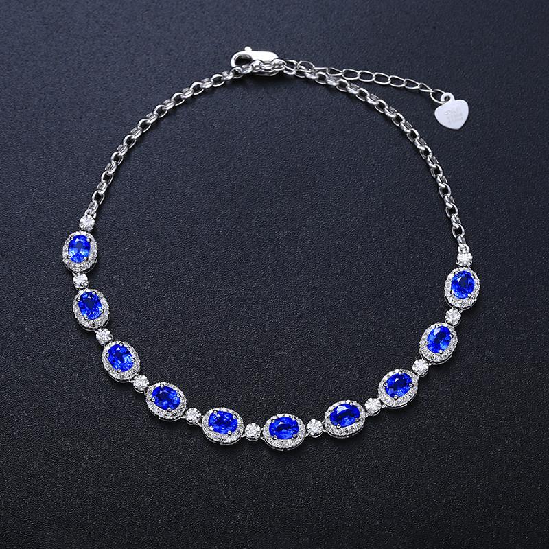 18k金镶矢车菊蓝蓝宝石手链  宝石参数:2.85ct  配石:钻石171颗,总重4.49克,链长: