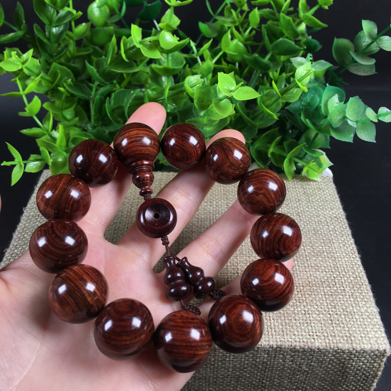 海南黄花梨紫红油梨1.8、集虎皮纹、天眼、密集的黑油线!性价比高、收藏价值高!