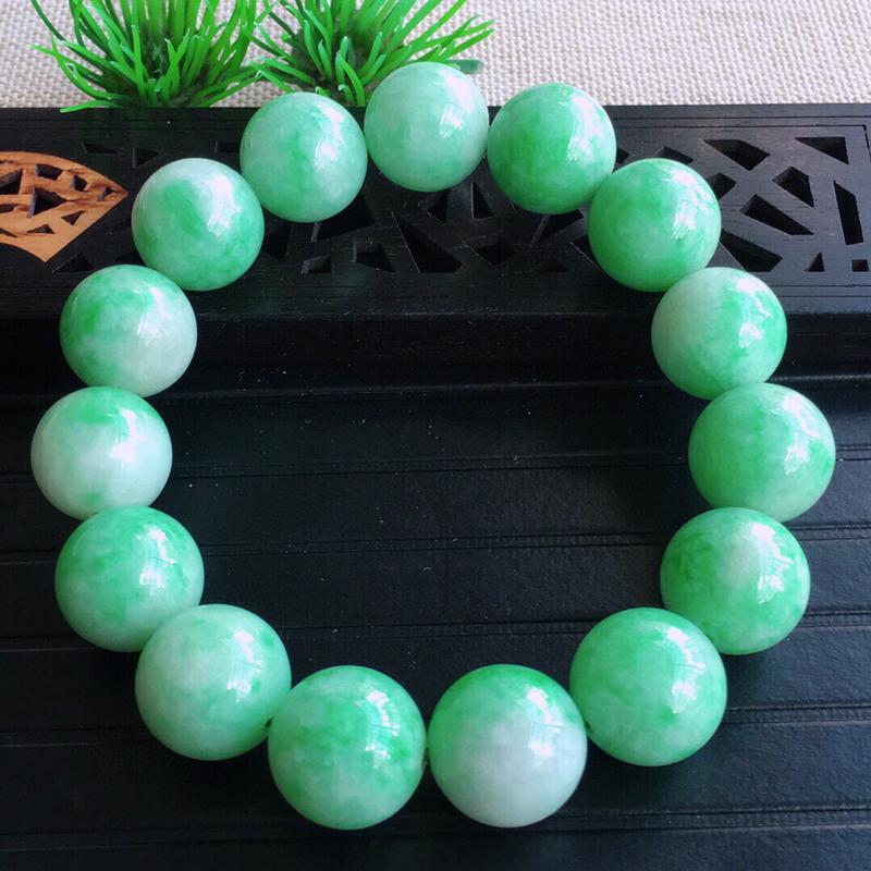 天然缅甸老坑翡翠A货绿色圆珠子手链,料子细腻柔洁,尺寸珠子直径15mm,重量87.45g。
