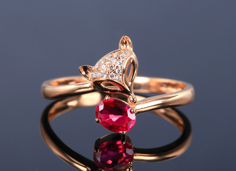 18k金镶红宝石戒指 宝石参数:0.38ct  配石:钻石16颗,总重1.76克,圈口:14号(可改